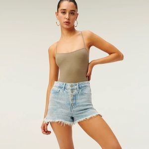 Good American bombshell jean shorts exposed button